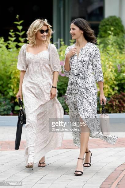 Influencer Gitta Banko wearing sunglasses by Sunglass Hut, black sandals by Ingolstadt Village, a beige long mxi dress by ba&sh and a black bag by...