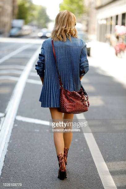 Influencer Gitta Banko wearing white denim shorts by True Religion a black tank top by iheart a denim blazer with a pleated back by RedValentino pink...