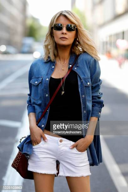 Influencer Gitta Banko wearing white denim shorts by True Religion a black tank top by iheart a denim blazer with a pleated back by RedValentino a...