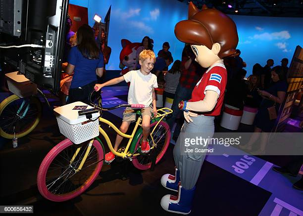 Influencer Jacob Ballinger checks out the latest line of YoKai Watch products from Hasbro at the YOKAI WATCH 2 preview event at Siren Studios on...