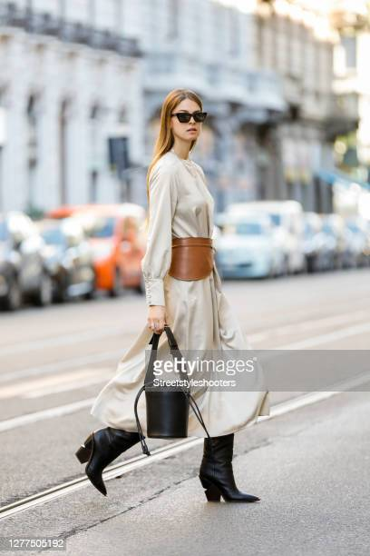 Influencer Jacqueline Zelwis, wearing a beige dress by Black Palms the Label, a brown beltbag by Sportmax, a black bag by Sportmax, black boots by...