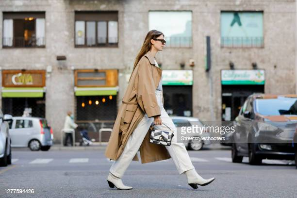 Influencer Jacqueline Zelwis wearing a beige trench coat by Rabens Saloner a beige shirt with blue batic pattern by Rabens Saloner a light beige...