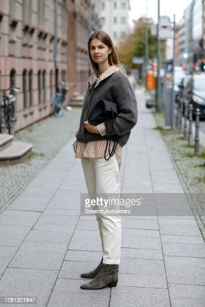 Influencer Jacqueline Zelwis, wearing a light brown and white striped shirt with big collar by Samsoe Samsoe, cream colored pants by Sezane, a taupe...