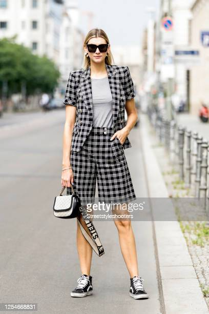 Influencer Kimyana Hachmann wearing a black and white checked short suit by Veronica Beard, a grey shirt by Grey Fashion Berlin, a bag by Stella...