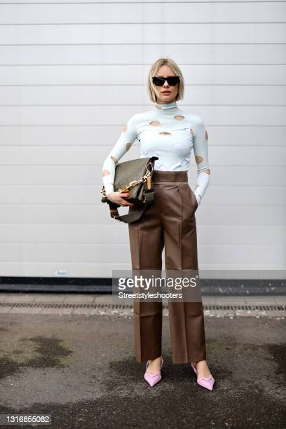 Influencer Lisa Hahnbueck wearing a white turtleneck pullover with cut out details by Prada, brown pants by The Frankie Shop, a khaki colored Coussin...