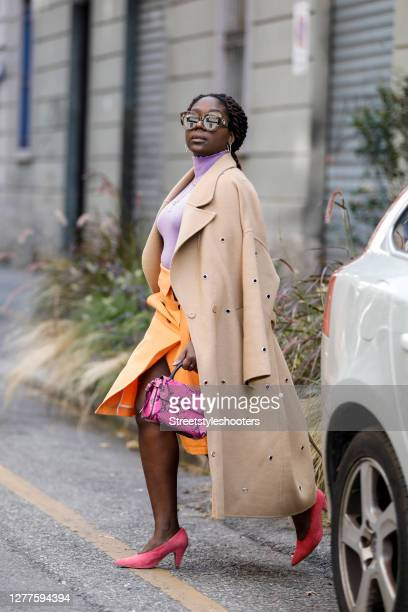 Influencer Lois Opoku wearing a purple colored top and a orange colored skirt by Dorothee Schumacher a beige coat with ponted cutouts by Lala Berlin...