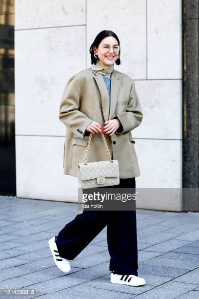 Influencer Maria Barteczko, wearing a beige oversized blazer by The Frankie Shop, a grey wool top by Rabens Saloner, blue wide leg pants by Arket,...