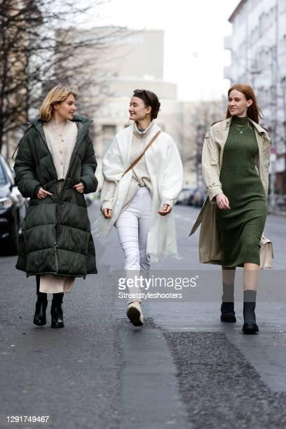 Influencer Marie von den Benken alias @regendelfin wearing a blonde fringe bob hairstyle, a long army green down puffer coat - LeGer by Lena Gercke,...
