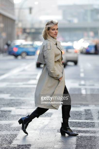 Influencer Marie von den Benken alias @regendelfin wearing a blonde fringe bob hairstyle, black ankle booties by H&M, a classic beige trenchcoat by...
