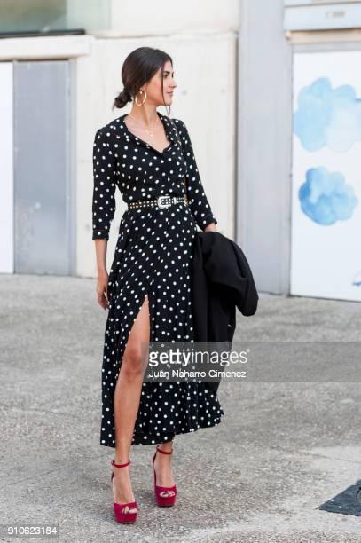 Influencer Mery Turiel wears Mango shoes Zara dress and belt Yves Saint Laurent handbag and Gabol baggage at Ifema during Mercedes Benz Fashion Week...