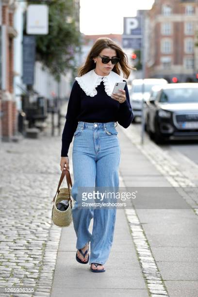 Influencer Sarah Lou Falk, wearing a dark blue pollover with a big white collar by Sando Paris, Jenas pants by Sando Paris, slipper by Hawaiianas, a...