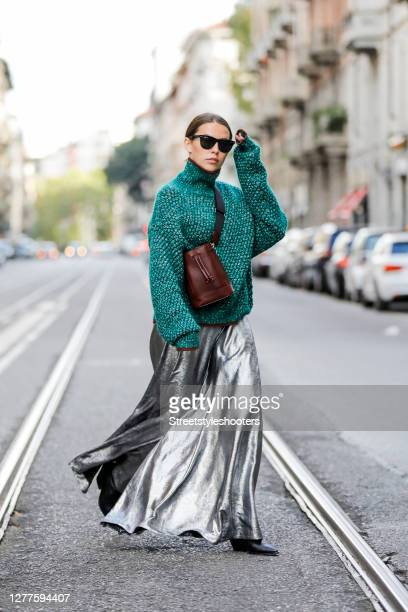 Influencer Sarah Lou Falk wearing a silver colored jumpsuit by Rabens Saloner a green Pullover by Sportmax a brown bag by Sportmax black boots by AGL...