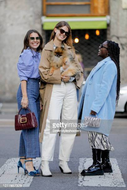 Influencer Sarah Lou Falk wearing a white blue striped blouse by Munthe blue patterned pants by Munthe blue heels by Custommade a purple colored bag...