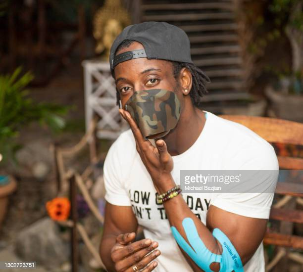 Influencer Shaka Smith poses for portrait wearing SpiderTech athletic mask at Giveback Day at The Artists Project on February 17, 2021 in Los...