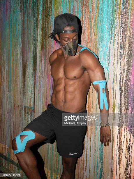 Influencer Shaka Smith poses for portrait wearing SpiderTech pre-cut athletic tape at Giveback Day at The Artists Project on February 17, 2021 in Los...