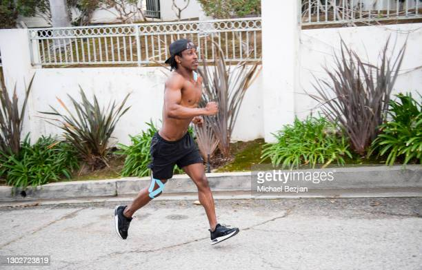 Influencer Shaka Smith works out wearing SpiderTech pre-cut athletic tape at Giveback Day at The Artists Project on February 17, 2021 in Los Angeles,...