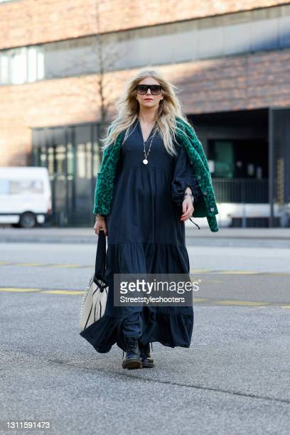 Influencer Sueheyla Alapinar alias Sue Blond wearing a long black maxi dress by Devotion, a green jacket with black leopard print by Leon & Harper,...