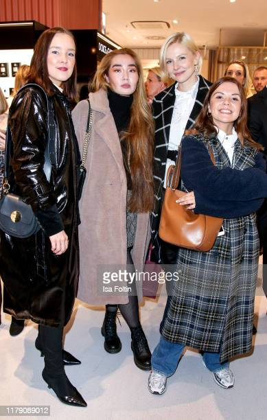 Influencer Tina Haase influencer Anduka Enkhtur model and influencer Carolin Lauffenburger and influencer Amelie Stanescu attend the Douglas...