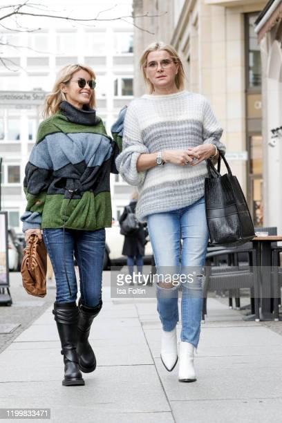 Influencerin Gitta Banko is wearing an oversized stripped turtleneck sweater by JW Anderson blue jeans by AG Jeans black biker boots by Bottega...