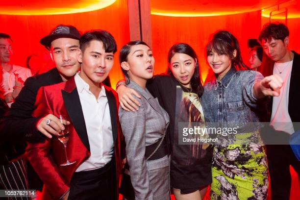 Influencers from China Jase Li Alston Chao Zhuang Natasha Lau YUYU and actress Chen Ran pose for a picture in the hotel's nightclub Electric Circus...