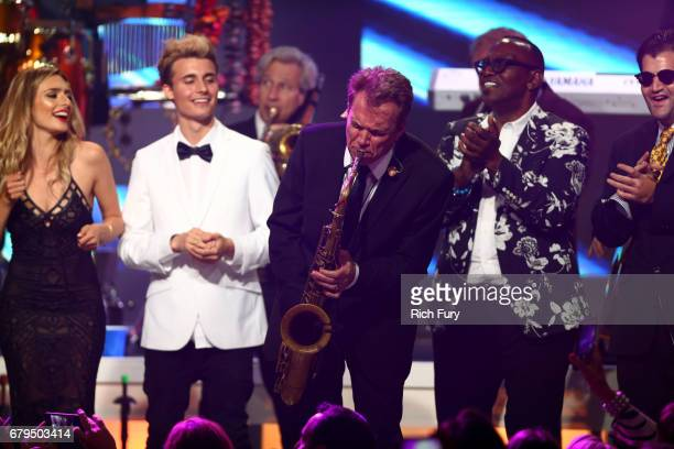 Influencers Kirsten Collins and Christian Collins Musicians Ray Herrmann and Randy Jackson and actor Jason Davis are seen onstage during the 24th...