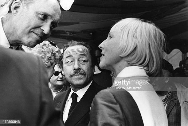 Influential American book publisher and poet James Laughlin and Pulitzer Prize-winning playwright Tennessee Williams listen to poet and...