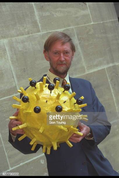 Influenze expert John Oxford with a model of the molecule for the 1998 flu vaccination
