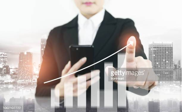 Info-graphic of business growth double exposure of woman is checking to smart phone to command business stock graph increasing.