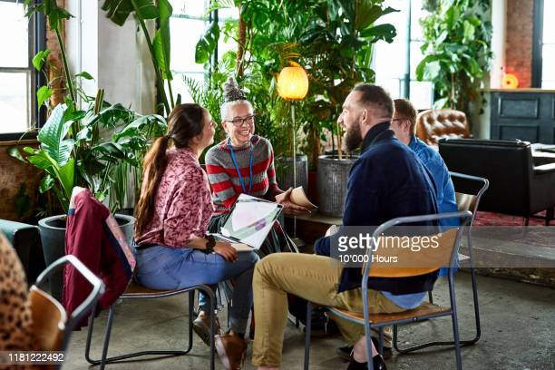 informal brainstorming session between colleagues in cafe - publicity event stock pictures, royalty-free photos & images