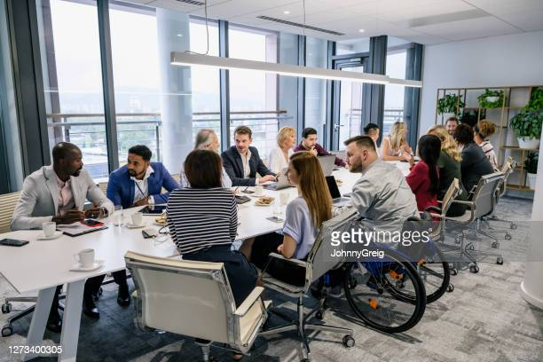 informal discussions between colleagues in board room - diversity stock pictures, royalty-free photos & images