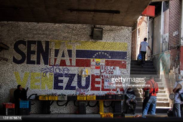Informal food food vendors work in the city center during the first day of the strict curfew ordered by President Maduro on March 22, 2021 in...