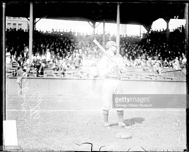 Informal fulllength portrait of baseball player George Gibson of the National League's Pittsburgh Pirates holding a baseball bat standing in front of...