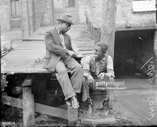 """Informal full-length portrait of Charles J. Correll and Freeman F. Gosden , lead actors in the radio program """"Amos 'n Andy,"""" portraying African..."""