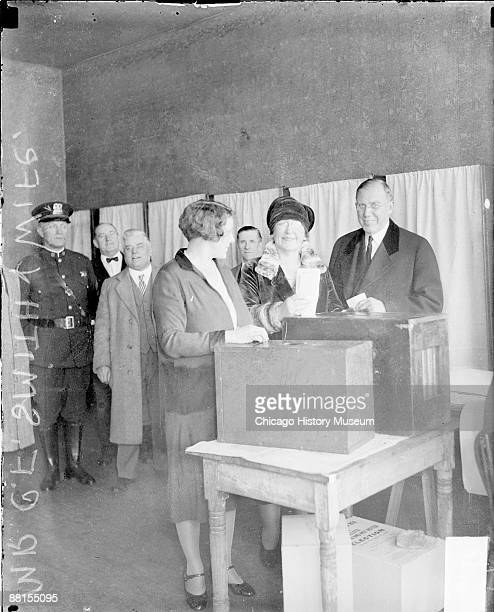 Informal fulllength portrait of Clayton F Smith Deputy Commissioner of City Works and his wife nee Mayme Paschen looking toward the camera standing...
