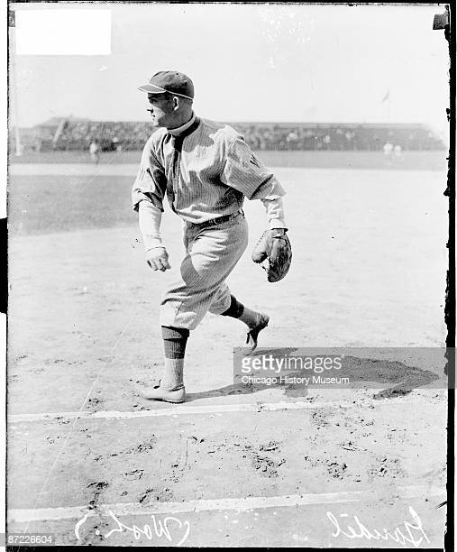 Informal fulllength portrait of first baseman Charles Arnold 'Chick' Gandil of the American League's Washington Senators following through after...