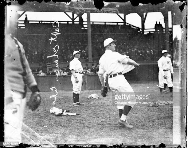 Informal fulllength portrait of Hall of Fame baseball player Frank Chance of the National League's Chicago Cubs baseball team following through after...