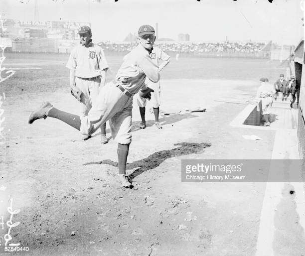 Informal fulllength portrait of Hall of Fame baseball player Ty Cobb of the American League's Detroit Tigers following through after throwing a...