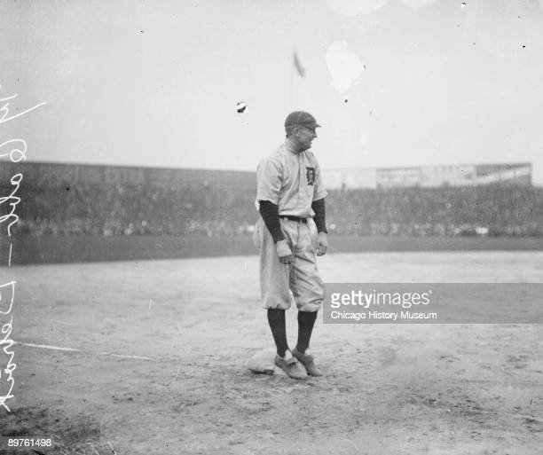 Informal fulllength portrait of Hall of Fame baseball player Ty Cobb of the American League's Detroit Tigers baseball team smiling while standing on...