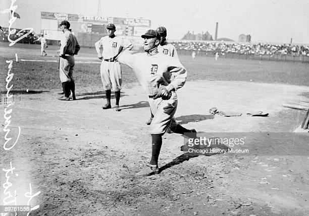 Informal fulllength portrait of Hall of Fame baseball player Ty Cobb of the American League's Detroit Tigers throwing a baseball standing on the...