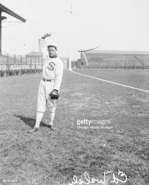 Informal fulllength portrait of Hall of Fame pitcher Ed Walsh of the American League's Chicago White Sox holding a baseball above his head while...