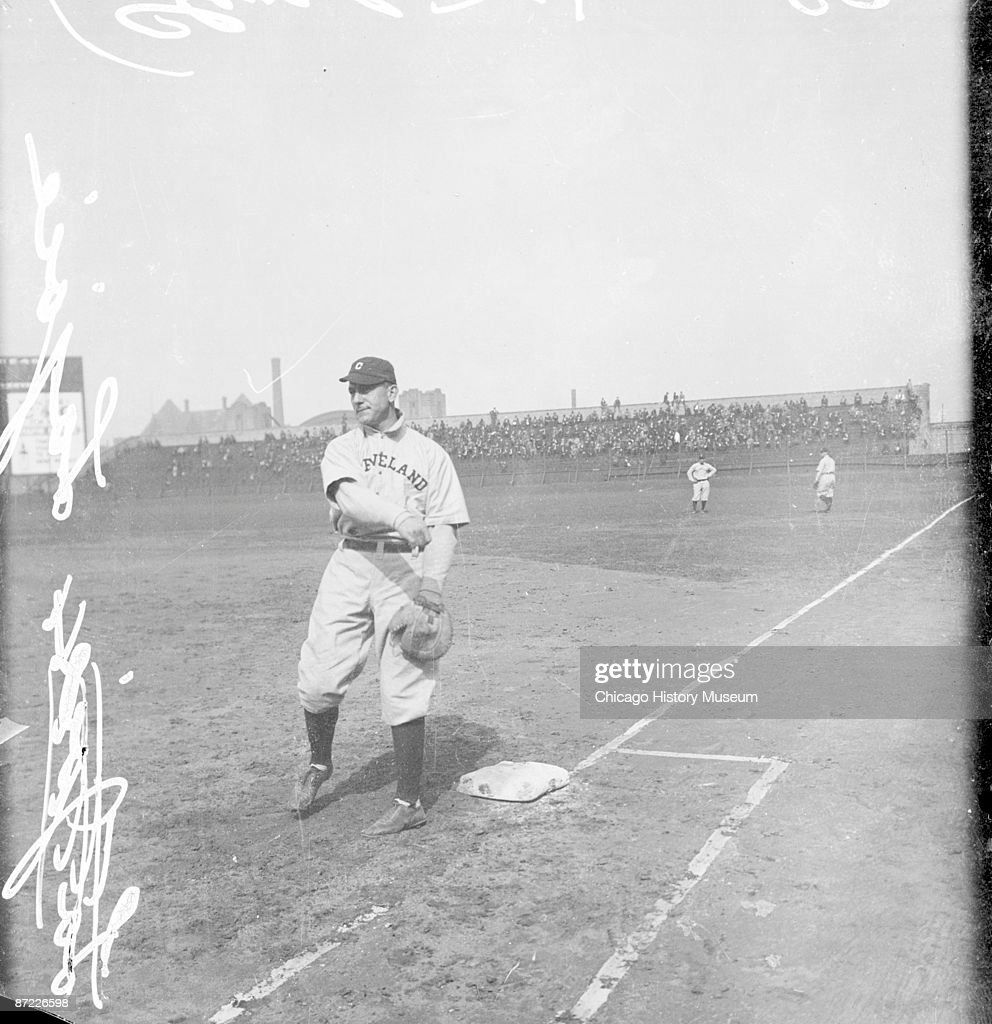 Informal full-length portrait of Hall of Fame second baseman Napoleon 'Nap' Lajoie of the American League's Cleveland Naps, following through after throwing a baseball, standing at first base on the field at Comiskey Park, in the Armour Square community area of Chicago, Illinois, 1912. From the Chicago Daily News collection.