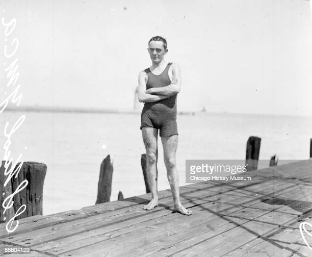Informal fulllength portrait of marathon swimmer S S Nichol involved in a river swimming marathon in the Chicago River standing on a dock along a...