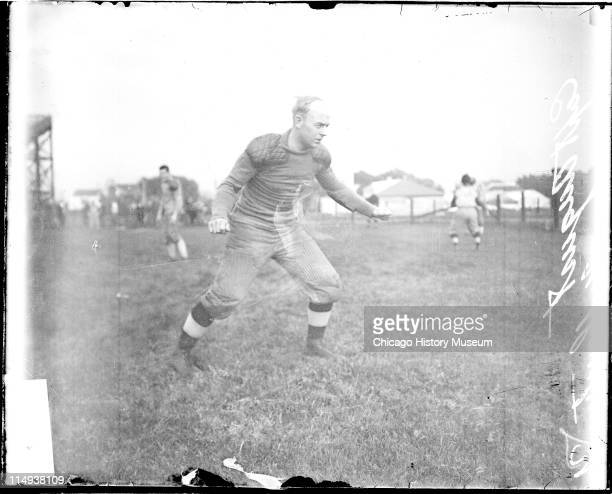 Informal full-length portrait of Northwestern University football player and captain Dave August standing in an athletic position on an athletic...