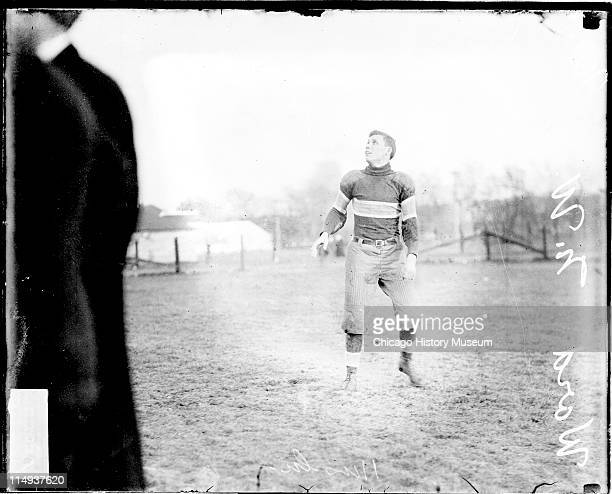 Informal fulllength portrait of Northwestern University football player Ward looking up standing on an athletic field in or near Evanston Illinois...