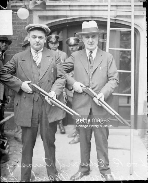 Informal fulllength portrait of Sergeant Owen Ward and Officer Edward Tussey of the Chicago Police Department holding rifles and looking toward the...