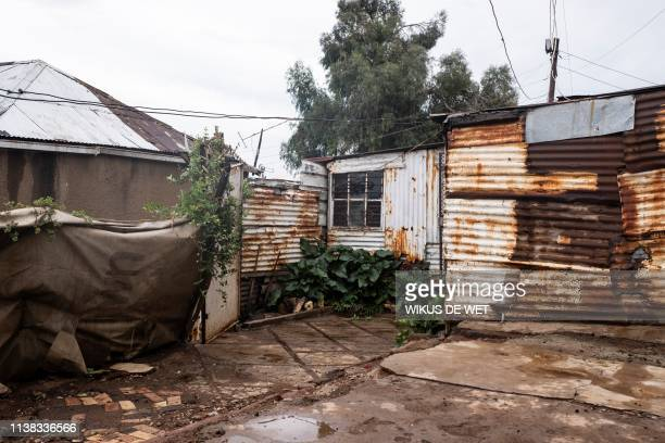 Informal housing built with corregated iron is seen on April 5 2019 in Kliptown near Soweto South Africa goes to the polls next month the country's...