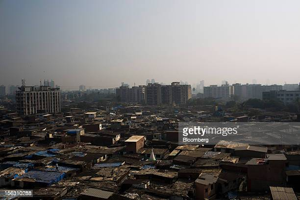 Informal housing stands in the Dharavi slum area of Mumbai India on Friday Nov 9 2012 Indian industrial production unexpectedly fell in September and...