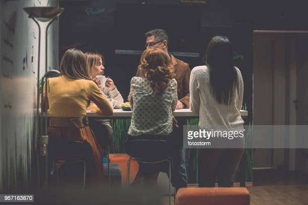 informal meeting in a cafeteria - coworking stock photos and pictures