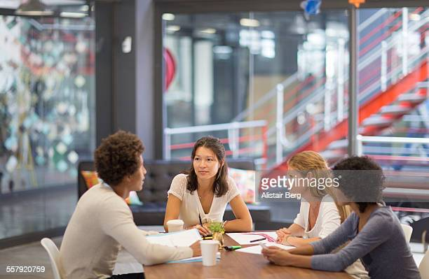 informal meeting in an advertising agency - 20 29 years stock pictures, royalty-free photos & images