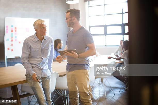 Informal meeting in an open plan office
